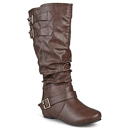 Decorative buckles and a slouchy design add a fashionable look to these faux leather boots by Journee Collection. These stylish round-toe boots feature raised seams, topstitching and easy pull-on styling. All measurements are approximate and were tak...