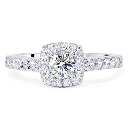 This womens ring features a 1/2ct center and 22 round cut natural diamonds. The diamonds are all set in solid 14k white gold.