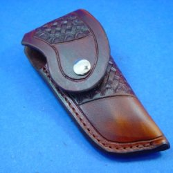 A Custom Made Leather Knife Sheath. It Is Made To Fit A Buck 110 Knife Or Similar. Made Out Of 8 Oz Leather, Tooled, Has A Snap, And Is Dyed Brown