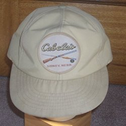 "Vintage New Old Stock Snapback Cap Cabela'S Sidney, Nebr. With Rod & Reel & Rifle 3"" Sewn-On Patch. Gore-Tex Fabric Tag And Additional Authentic Cabela'S Tag. Stored In Climate Controlled Warehouse. Rare Light Tan With 'Sparkly Letters' Patch!"