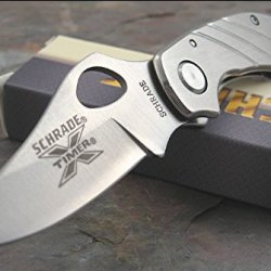 Schrade Sch501 X-Timer Framelock Knife With Stainless Handle With Lines, Clip Point Blade And Thumb Hole