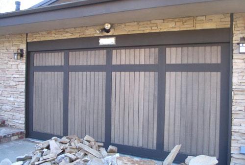 wood panel and vinyl garage door