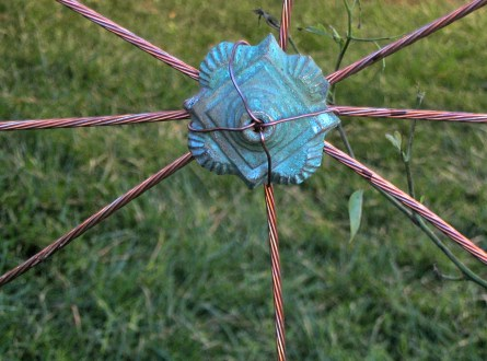 Antique medallion and copper wire fence