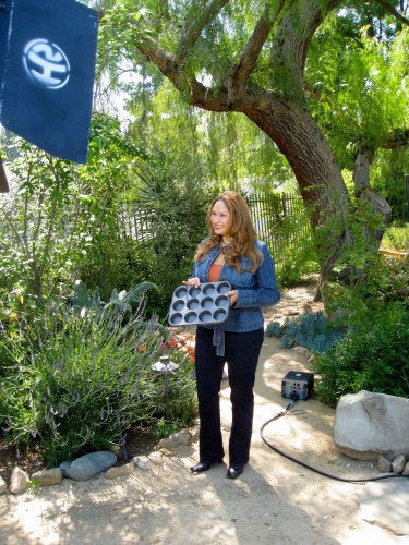 Shirley Bovshow holds a muffin pan turned garden planter