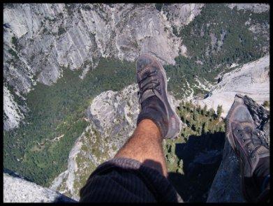 Sitting atop Half Dome in Yosemite, California
