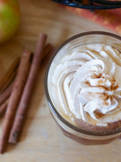 Homemade apple cider with spiced whipped cream