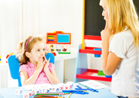 Child receiving speech therapy