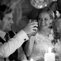 Bride and Groom toast at their dinner