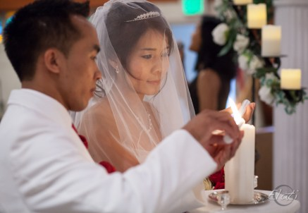 Wedding couple lighting candles