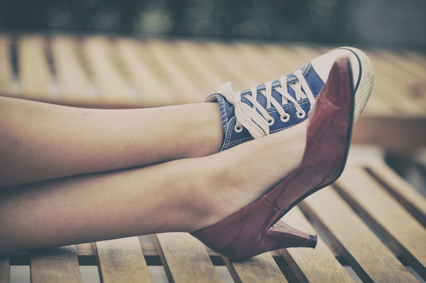 34238479 - woman legs in different shoes