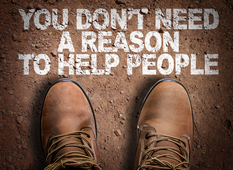 65025623 - text on road with boots background: you don't need a reason to help people