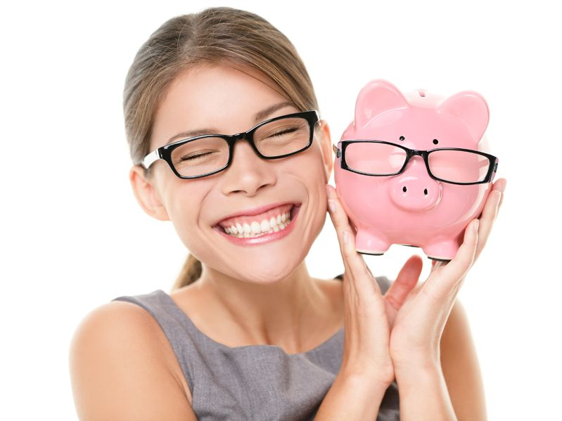 13524223 - glasses eyewear savings piggybank  woman happy excited over saving money buying glasses  young beautiful multiracial caucasian   chinese asian woman isolated on white background