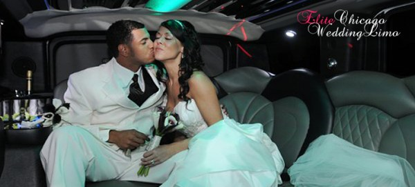 Beautiful couple kissing and hugging inside the limousine on a leather seat.