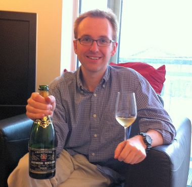 Guy modeling a rather nice bottle of fizz