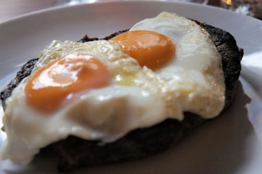 Steak with double fried eggs