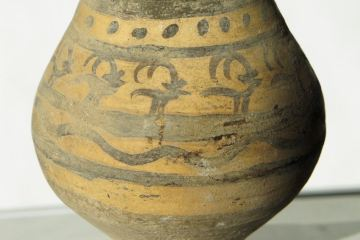 A small, pre-historic vase from the Harappan civilisation