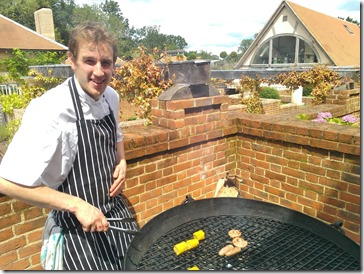 Cooking sausages at the LIme Wood Hotel