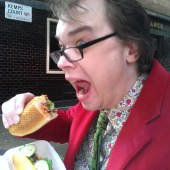 Davy scoffing banh mi