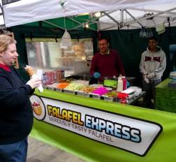 The Editor next to Falafel Express
