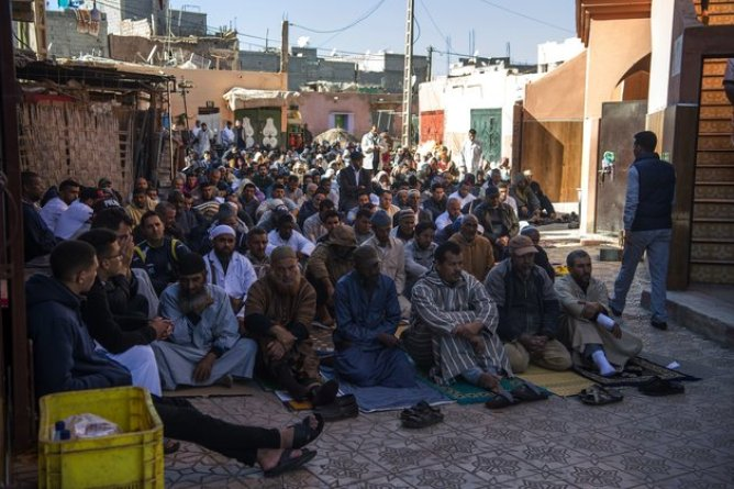 A picture taken on December 21, 2018, shows people gathered during the Friday prayers in front of a mosque in the neighbourhood of Azzouzia in the Moroccan central city of Marrakesh, where Abdelrahim el-Khayali and Ouziad Younes, two of the suspects who were arrested following the murder of two Scandinavian hikers in Morocco's High Atlas mountains lived. - The bodies of Danish student Louisa Vesterager Jespersen, 24, and 28-year-old Maren Ueland from Norway were found on December 17, after the two friends had pitched their tent at an isolated mountain site two hours' walk from the tourist village of Imlil. (Photo by FADEL SENNA / AFP) (Photo credit should read FADEL SENNA/AFP/Getty Images)