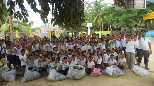 Our growing family: With students of Maytegued Elementary School.