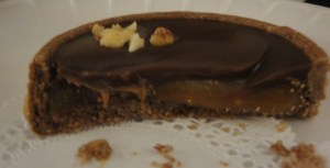 half slice of chocolate tart