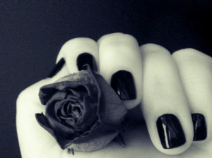 polished finger nails holding a rose courtesty of Plumptuous Pea