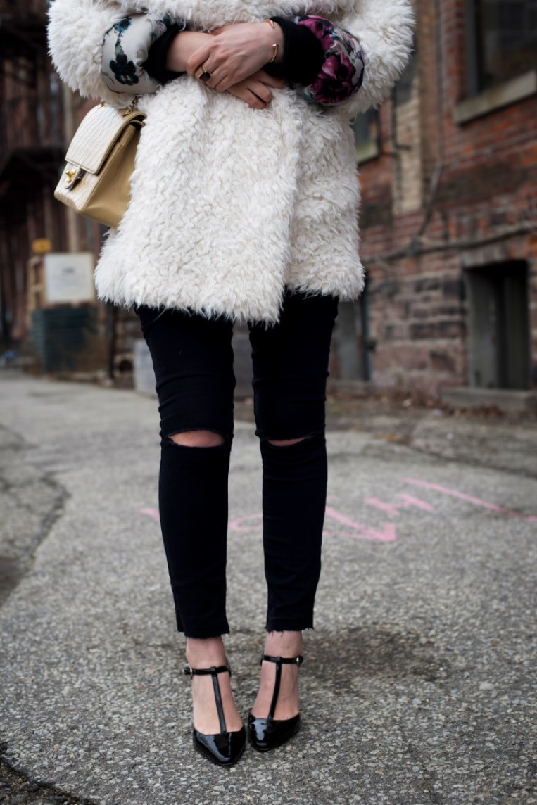 Chanel 2.55 paired with faux fur and ripped denim