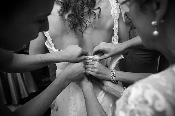 Dennis Drenner Photographs - baltimore museum wedding - bride putting on dress