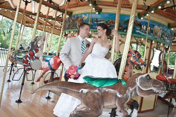couple riding carousel (photo by tammy labar photography via emmaline bride)