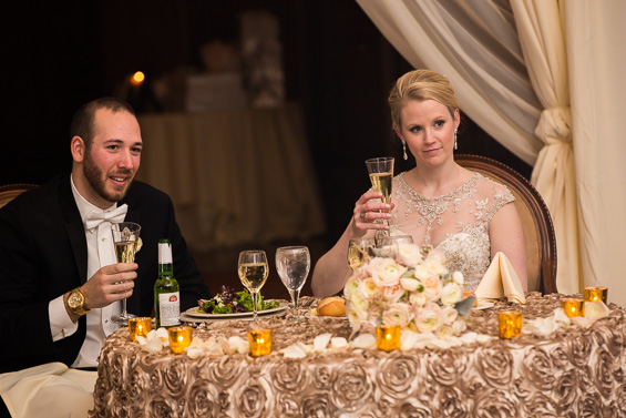 bride and groom listen to toasts at sweetheart table - photo: Daniel Fugaciu Photography | via http://emmalinebride.com