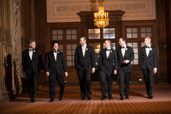 groom and groomsmen enter hotel - photo: Daniel Fugaciu Photography | via http://emmalinebride.com