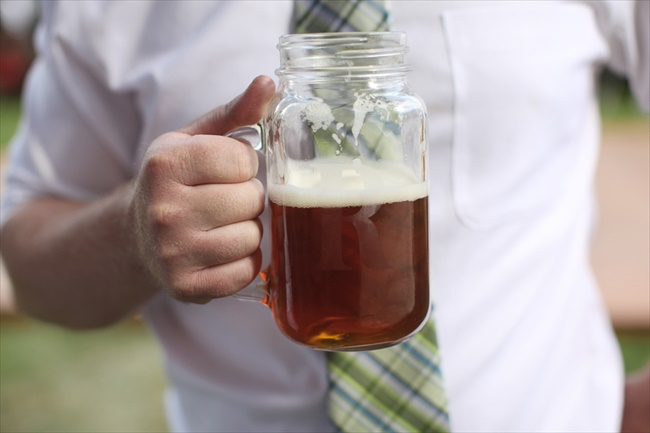 Mason Jar Beer Mug held by guest at wedding reception