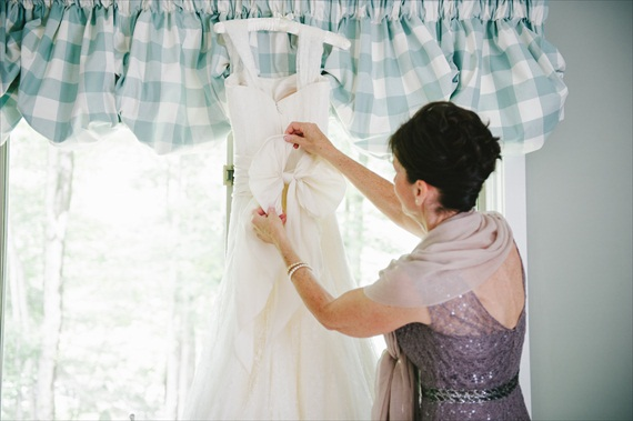 bride's mom adjusting bow on wedding dress - michelle gardella photography - Handmade Connecticut Wedding