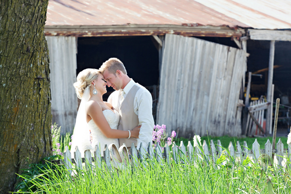 KimAnne Photography - iowa backyard wedding - bride-groom-picket-fence