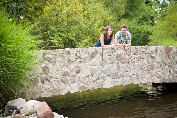 Scott Smith Photography - couple looking over stone bridge at Manor House engagement shoot at Prophecy Creek