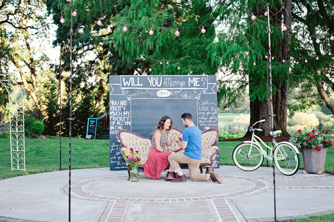 couple proposal by chalkboard sign in styled shoot| Photo: White Ivory Photography | via http://emmalinebride.com/real-weddings/hipster-engagement-session-what-does-one-look-like/