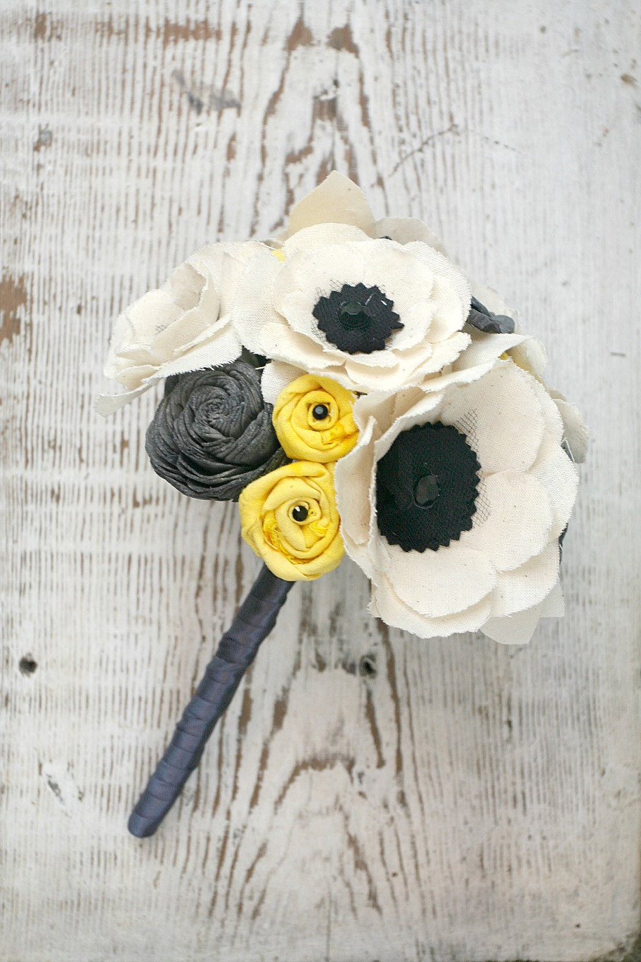 anemone wedding bouquet with black and white and yellow and gray