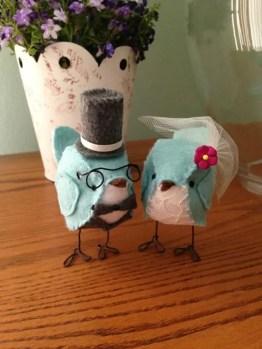 bird cake topper groom wearing glasses