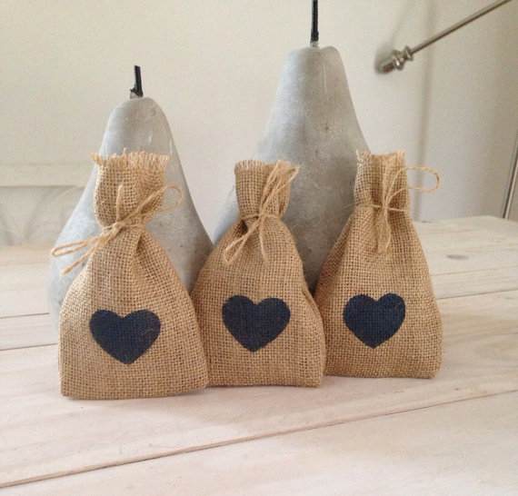blue heart favor bags | 35 Easily Beautiful Ways to Use Burlap for Weddings http://emmalinebride.com/rustic/ways-use-burlap-weddings/