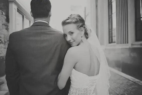 Wear a Veil or Not (via EmmalineBride.com) - bride with veil photo by maria mack photography