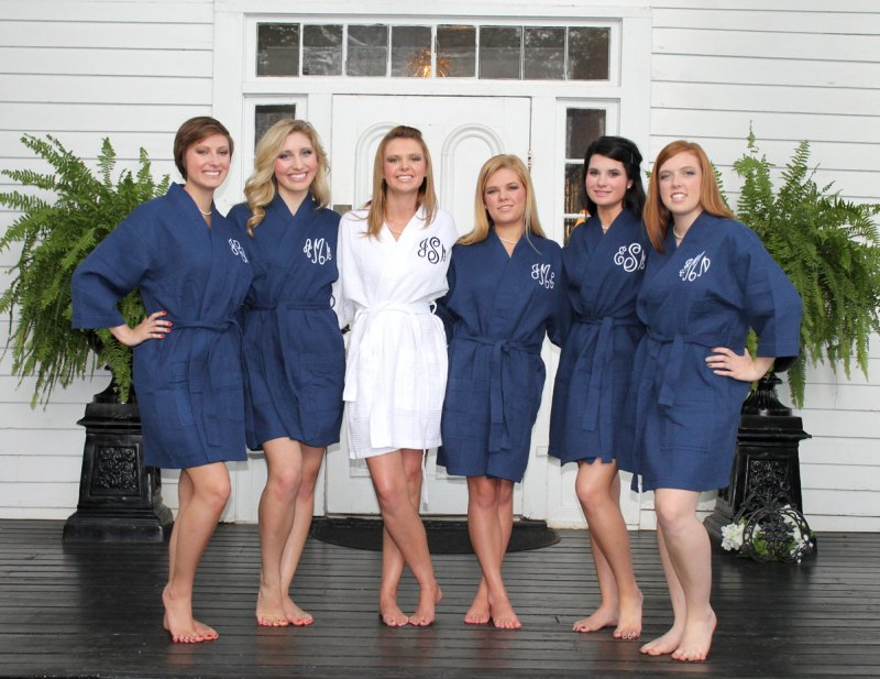 bridesmaid robes navy blue and white | via http://emmalinebride.com/decor/navy-and-white-wedding-ideas/ | via 21 Navy and White Wedding Ideas