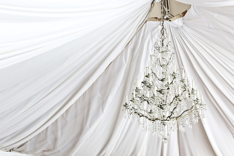 Chandelier in the ceremony / reception tent | Photographer: Melissa Prosser Photography | via http://emmalinebride.com/real-weddings/colleen-ryans-lovely-savannah-wedding-at-the-mansion-on-forsyth-park
