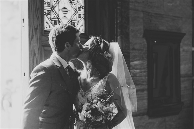 The bride and groom kiss | Photo: Searching for the Light Photography LLC | via http://emmalinebride.com/real-weddings/colorado-chic-wedding-kendall-brian/