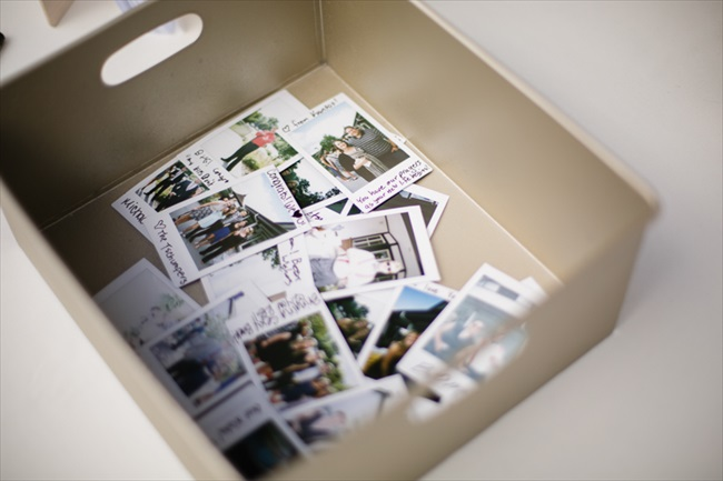 Guests snapped polaroid photos and wrote notes and their names on them, in lieu of a traditional guest book | Photo: Searching for the Light Photography LLC | via http://emmalinebride.com/real-weddings/colorado-chic-wedding-kendall-brian/