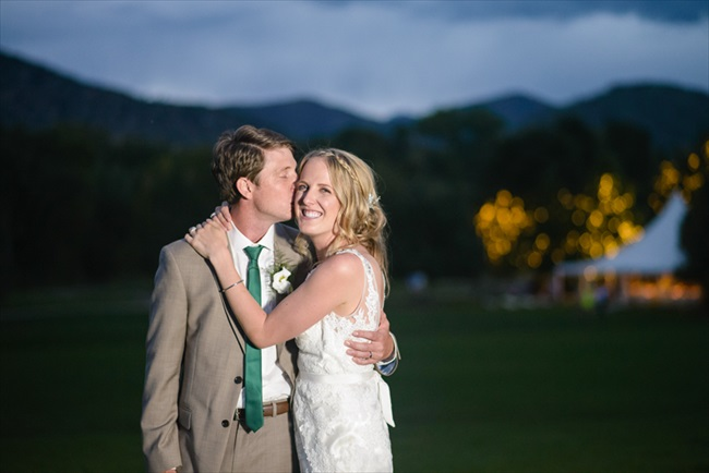 The groom kisses his bride | Photo: Searching for the Light Photography LLC | via http://emmalinebride.com/real-weddings/colorado-chic-wedding-kendall-brian/