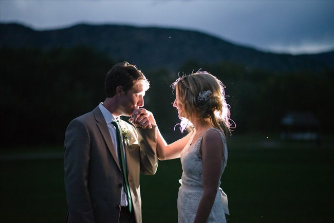 The groom kisses his bride's hand | Photo: Searching for the Light Photography LLC | via http://emmalinebride.com/real-weddings/colorado-chic-wedding-kendall-brian/