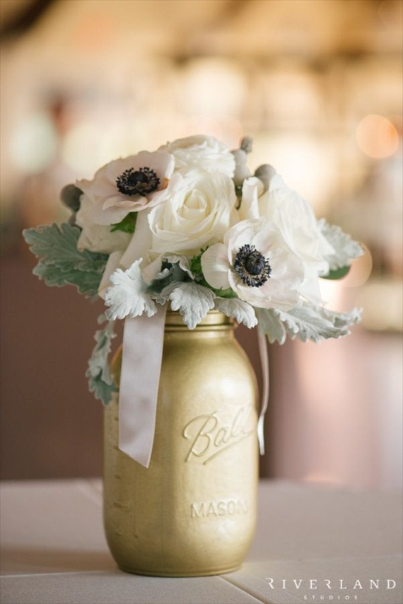 One of my favorite gold inspired wedding ideas is a gold painted mason jar. It makes an instant-glam centerpiece.  I especially love how the anemones pop against the gold paint.