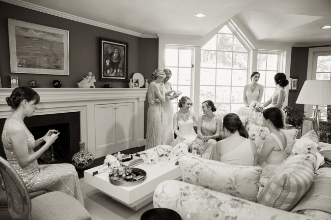 bride and bridesmaids relax at Connecticut waterfront wedding - photo: Melani Lust Photography | via http://emmalinebride.com