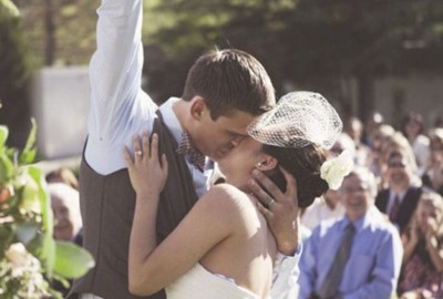 enthusiastic groom during first kiss